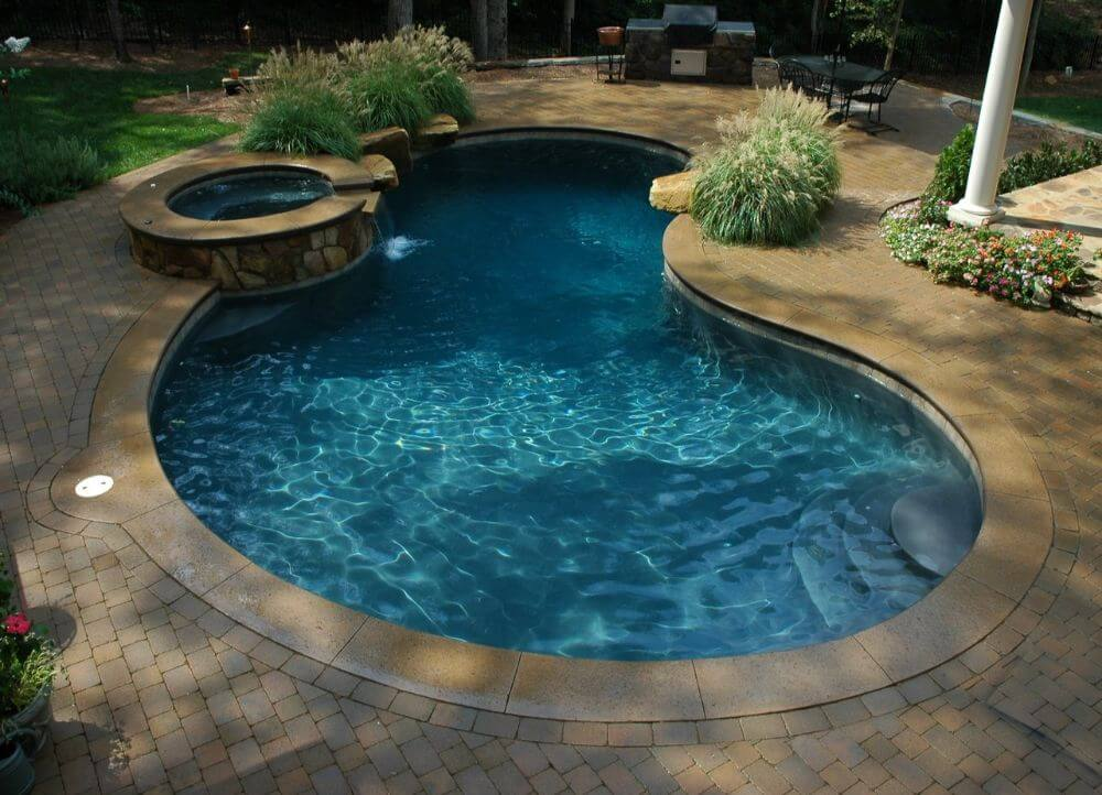 Freeform pool design gallery blueterra pool construction for Pool design hours